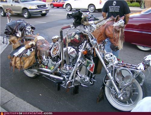 WTF picture of a Harley style motorcycle that looks like a plastic horse.