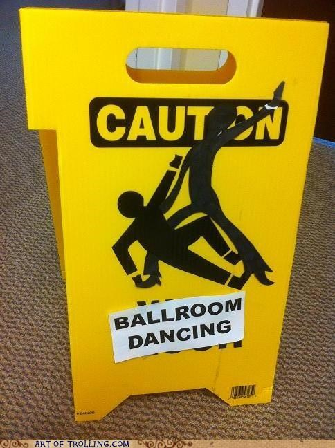 dancing,IRL,sign,wet floor
