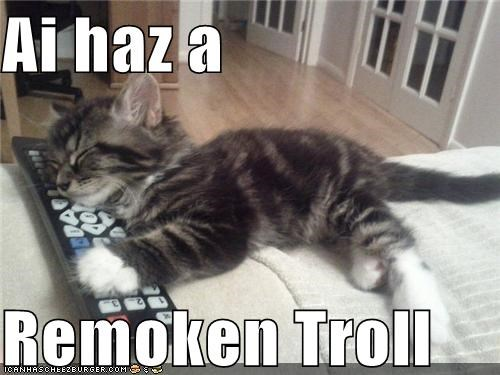 caption captioned cat i has kitten lolwut misunderstanding remote remote control sleeping troll - 5089708544