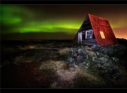 aurora borealis,getaways,Hafnarfjörður,hut,Iceland,long exposure,night photography,northern lights,stars