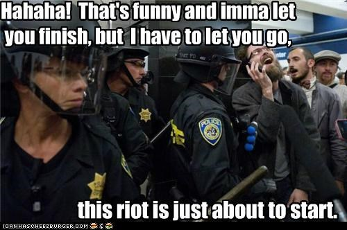 calls,cell phones,dumb,laughing,police,Pundit Kitchen,riot gear,riots,talking