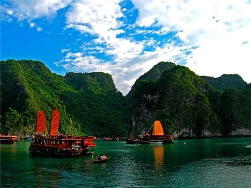 asia,bay,boats,clouds,green,ha long bay,hills,mountains,ocean,southeast asia,Vietnam,water