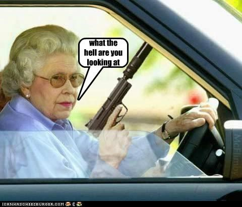 Badass,car,driving,gun,on a mission,queen,the queen,what the hell,wtf