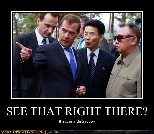 distraction hilarious Kim Jong-Il looking at things pointing
