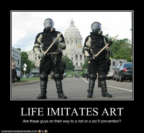 LIFE IMITATES ART Are these guys on their way to a riot or a sci fi convention?