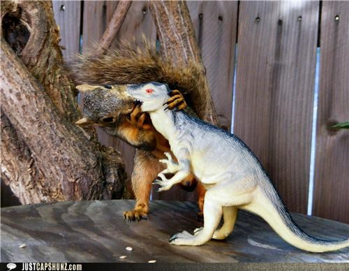animals caption contest dinosaurs kissing squirrels toys wtf - 5157742848