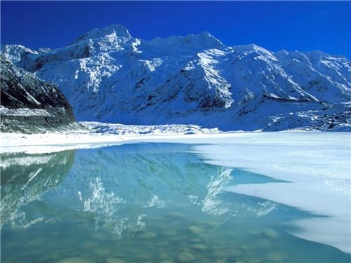destination of the week first class ticket getaways mountains new zealand reflection snow southern alps user submitted - 5168422400