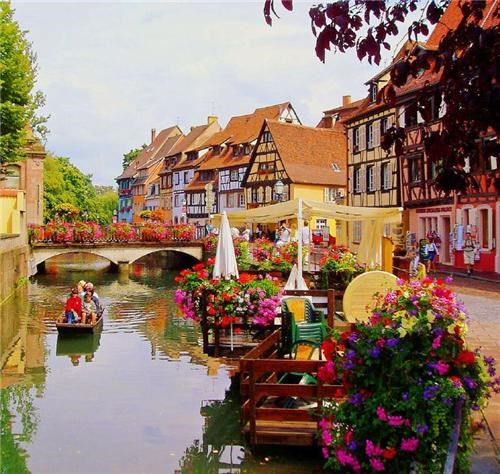 alsace,colmar,colorful,europe,flowers,france,getaways,river,village,vivid colors