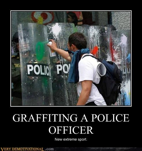 GRAFFITING A POLICE OFFICER New extreme sport.