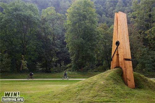 art clothespin earth grass installation park sculpture