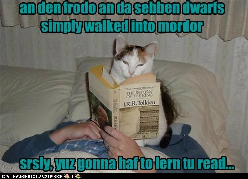 book caption captioned cat ending human illiterate learn Lord of the Rings lying need read reading story