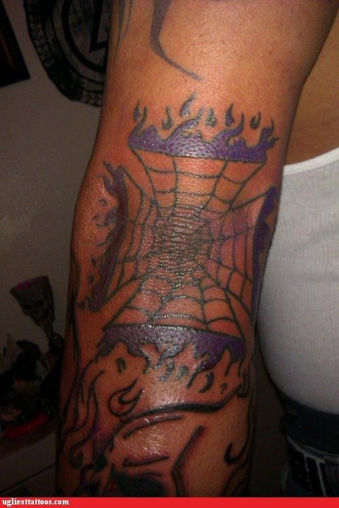 prison tattoos,purple flames,spider web