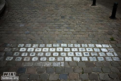 computer hacked irl keyboard qwerty Street Art technology