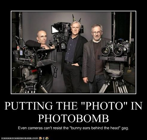 """PUTTING THE """"PHOTO"""" IN PHOTOBOMB Even cameras can't resist the """"bunny ears behind the head"""" gag."""