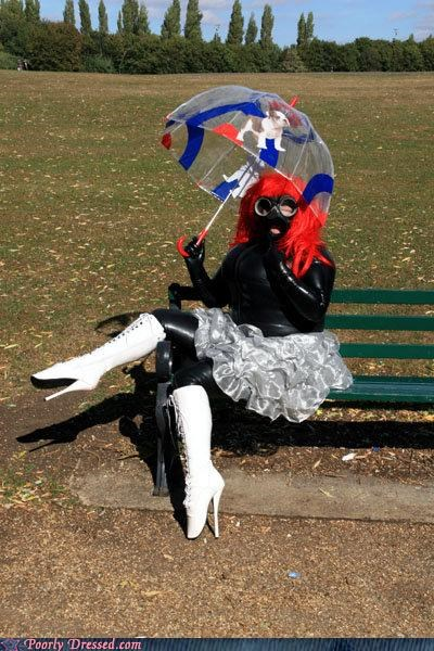 Fetish,gimp,park,photoshoot,umbrella
