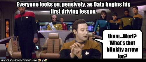 Everyone looks on, pensively, as Data begins his first driving lesson. Umm...Worf? What's that blinkity arrow for?