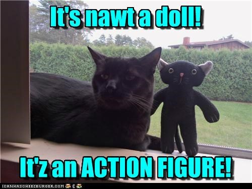 action figure caption captioned cat correction defensive doll figure not toy
