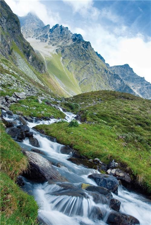 alps,austria,beautiful,clouds,europe,getaways,green,Hall of Fame,hillside,mountains,river,stream,water