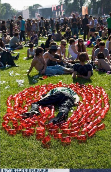 alcoholism beer cup face down festival grass passed out