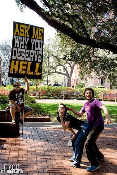 jerks mocking Protest religion sign silly