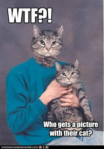 WTF?! Who gets a picture with their cat?