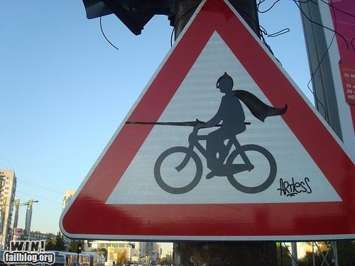 batman,bike,costume,hacked irl,joust,sign,warning