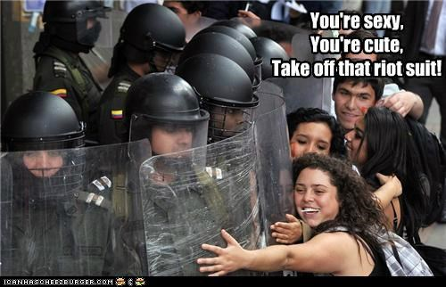 barricade,columbia,cute,happy,hugging,hugs,Pundit Kitchen,riot police,riot suit,sexy,Student Protest