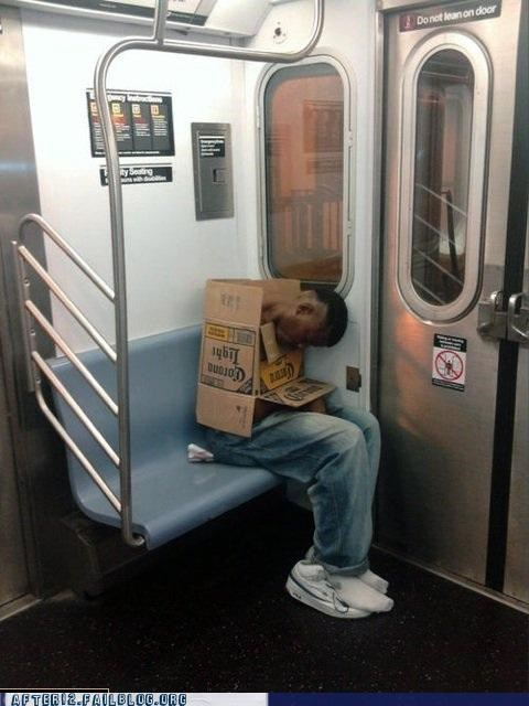 beer,box,cardboard,drunk,passed out,public transportation,train