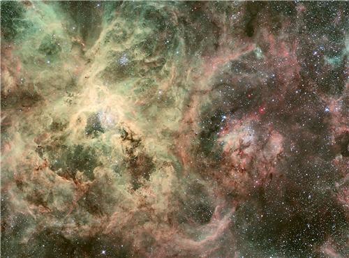 awesome cosmic getaway of the week cosmos getaways outer space tarantula nebula vivid colors - 5402401024