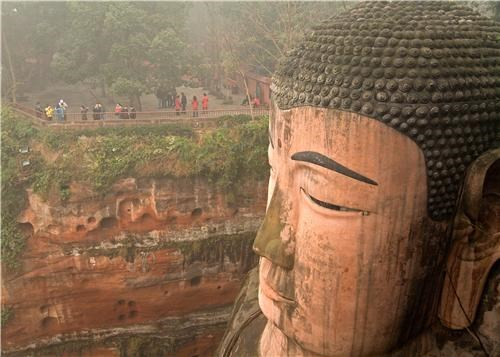 asia,buddha,China,cliff,getaways,religious,sculpture