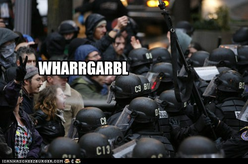 protestor getting peppersprayed in the face; caption: WHARRGARBL