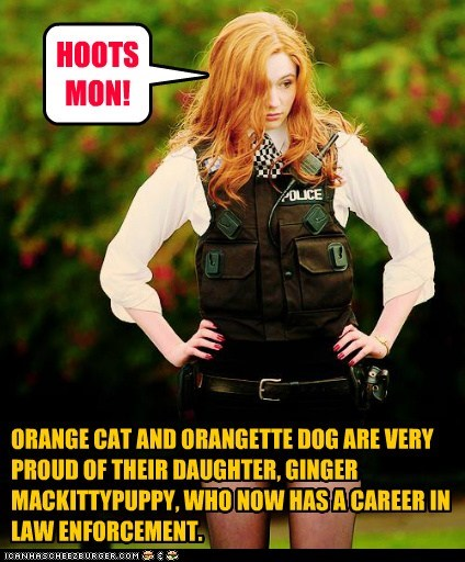 ORANGE CAT AND ORANGETTE DOG ARE VERY PROUD OF THEIR DAUGHTER, GINGER MACKITTYPUPPY, WHO NOW HAS A CAREER IN LAW ENFORCEMENT. HOOTS MON!