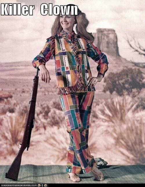 Creepy killer clown lady with a shotgun smiles even creepier.
