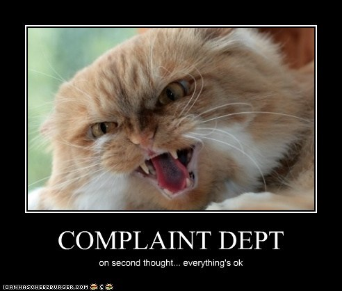 angry caption captioned Cats complaining complaint department complaints department hissing never mind - 5517834496