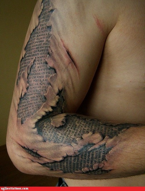 arm tattoo Hall of Fame tattoo WIN text under skin ugliest tattos