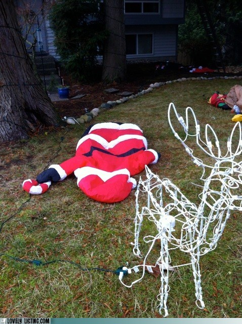 flat,inflatable,Sad,santa,yard