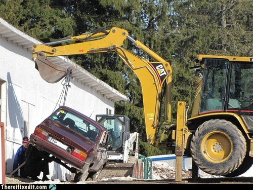 backhoe holding it up Professional At Work - 5548111104