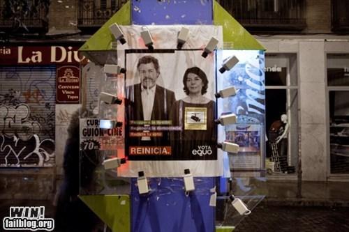 camera hacked irl politics poster Street Art surveillance - 5558943232