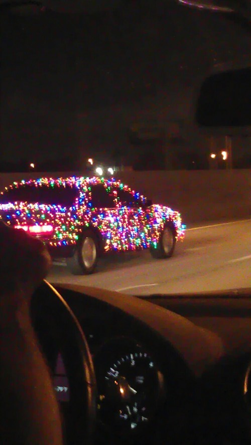 car,chirstmas lights,crazy,decorations,driving,highway