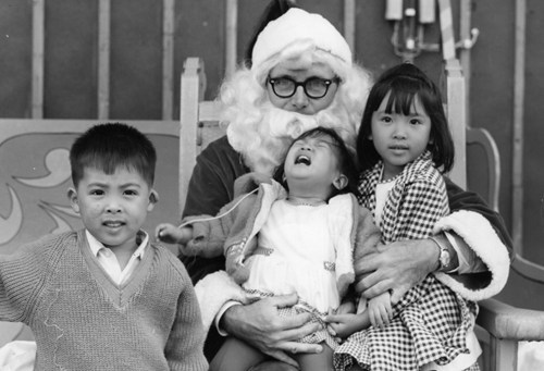 black and white creepy crying family mall santa