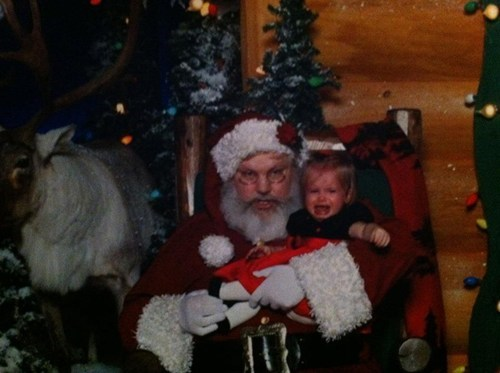 angry baby crying grimace mall santa scary teeth