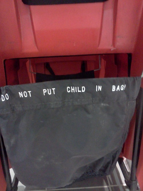 child in bag,it-doesnt-go-there,no not there