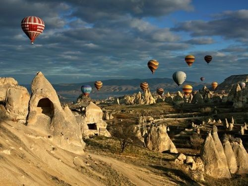 clouds,desert,flying,getaways,hot air balloons,Turkey