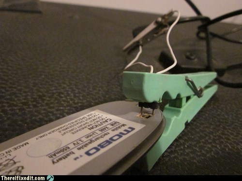 cell phone charging clothes pin wtf - 5704669696