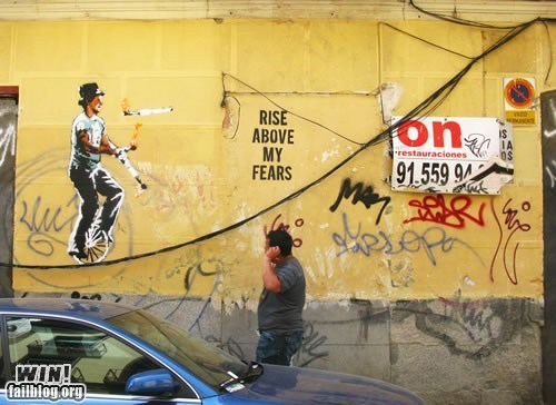 balance,graffiti,hacked irl,juggle,Street Art,unicycle,wire