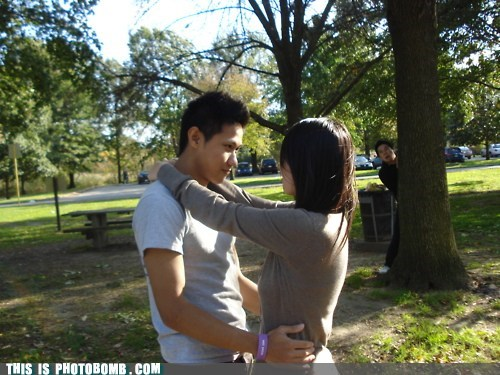 behind the tree cheater couple creepy sneakers park - 5710693632