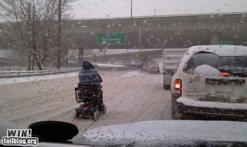 cars driving freeway scooter snow traffic