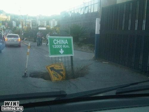 China driving hacked irl hole road sign