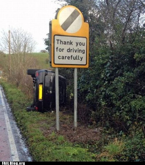 cars driving irony signs