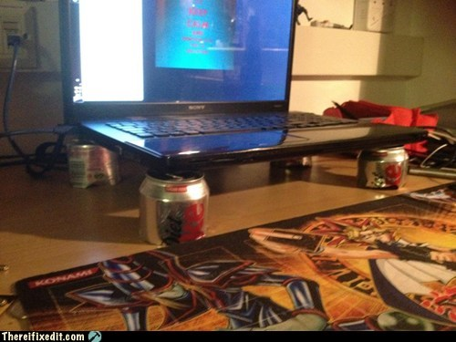 cans,cooling,holding it up,laptop repair,soda